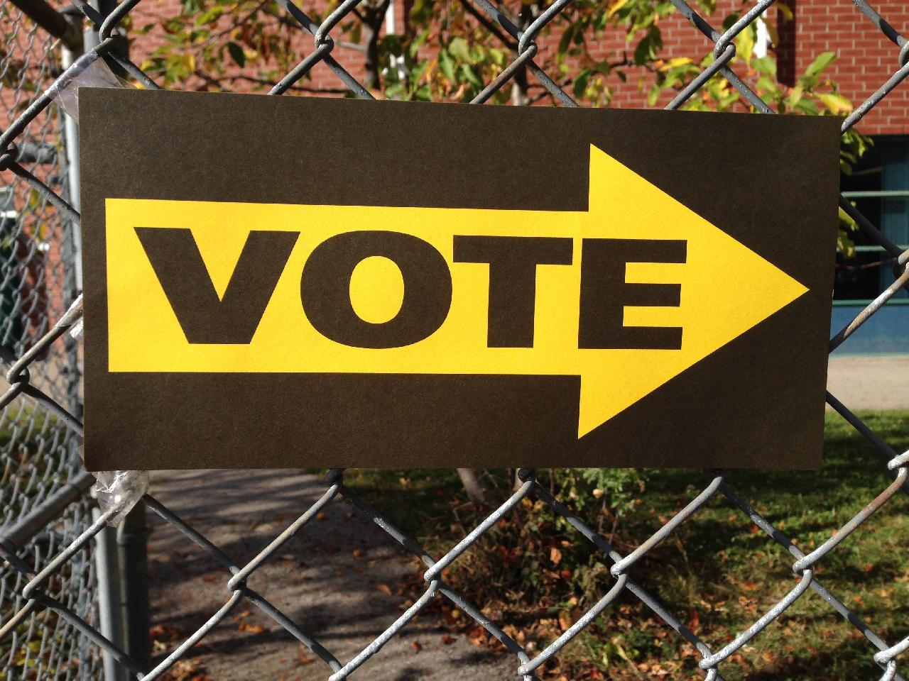 A sign that says Vote