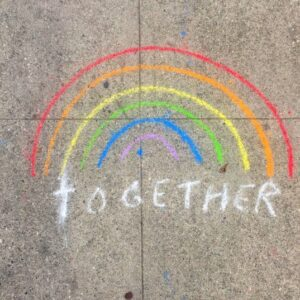 chalk-rainbow with the word Together at the bottom of the rainbow
