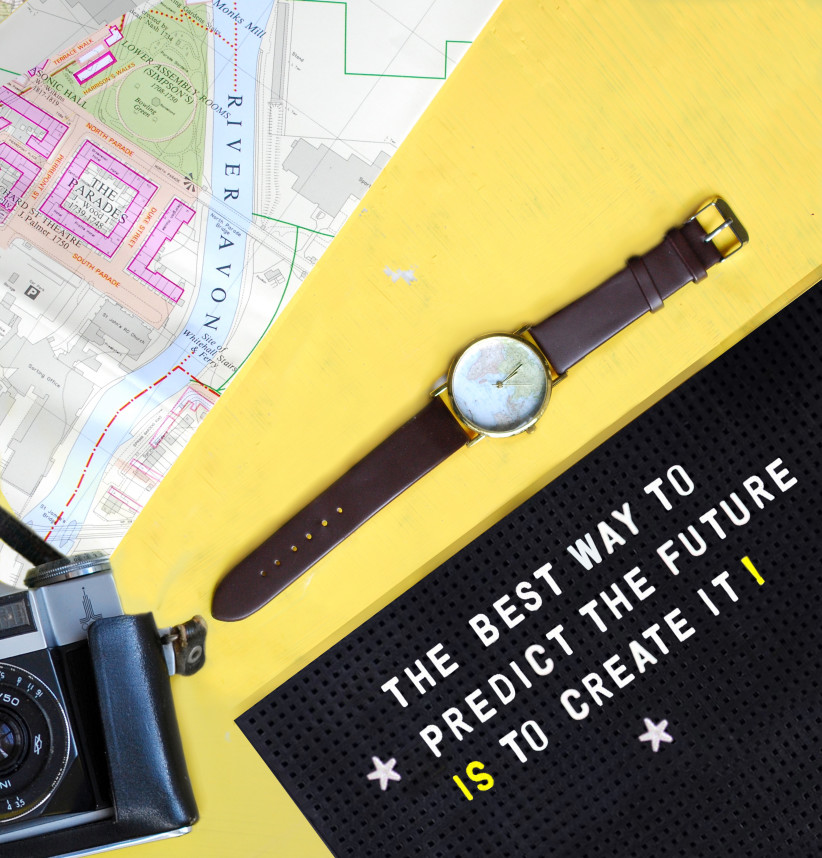 flat-lay-with-watch-camera-and-map-inspirational-quote-on-pegboard-yellow-background_t20_1J0Gmg