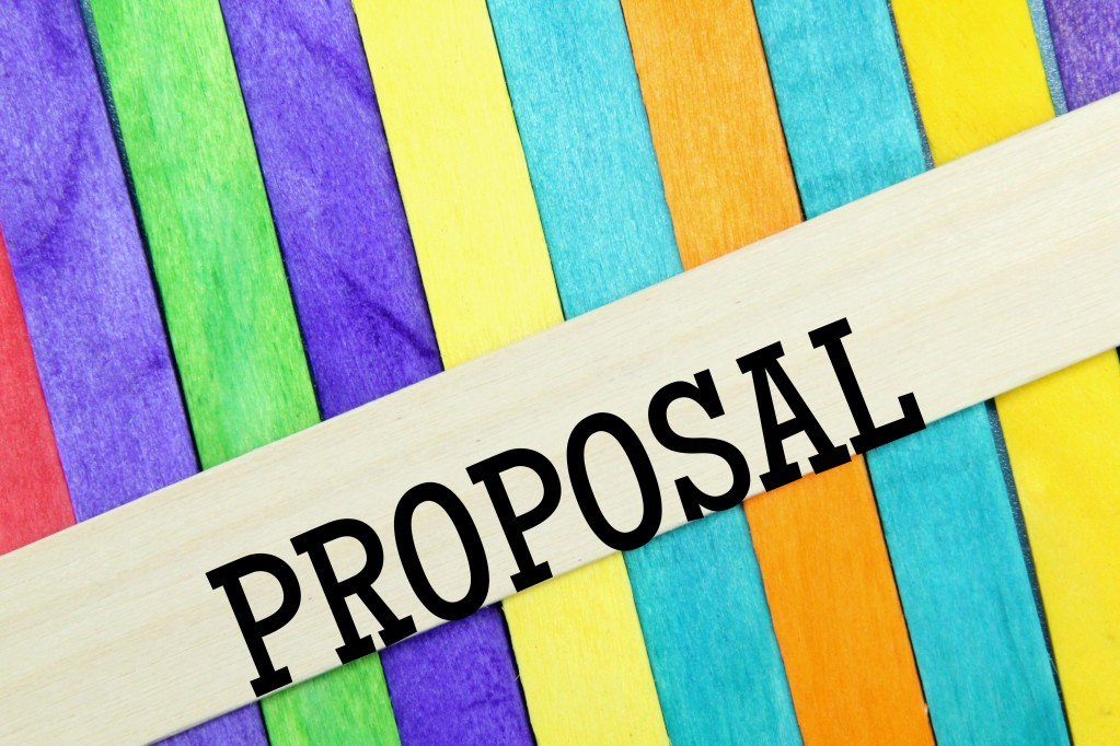 """a multicolored background with the word """"proposal"""" in front"""